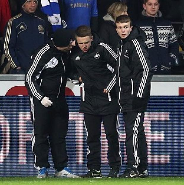 Charlie Morgan, centre, was the ball boy at the centre of the Eden Hazard dismissal