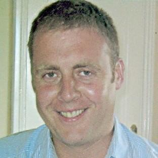 Detective Garda Adrian Donohoe was shot during a botched robbery in the Irish Republic