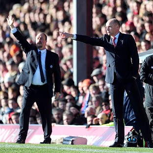 Uwe Rosler, right was disappointed his Brentford side did not hold on to beat Chelsea