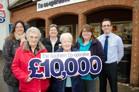 Charity representatives recieve £10,000 from the co-operative