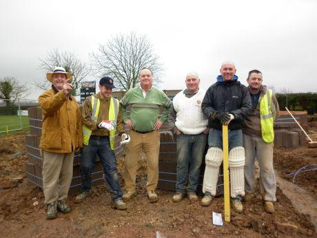 Nigel Green, left, and Andrew Green, centre, oversee work at the new clubhouse at Odiham and Greywell Cricket Club