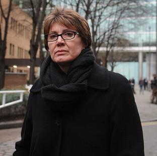 April Casburn leaves Southwark Crown Court after being found guilty of trying to sell information to the News of the World