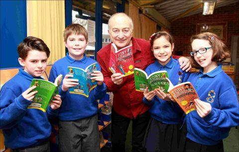 Author and actor Tony Robinson with pupils at St Peter's Catholic Primary School