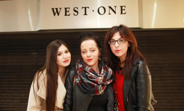 Staff Caroline Javor, Vicky Cullen and Poppy Gale outside the shut-up store.