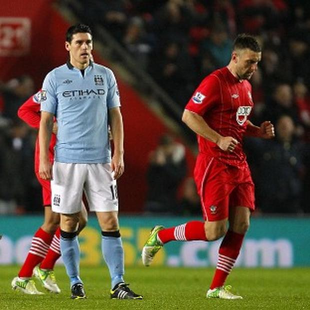Gareth Barry, left, scored an own goal as City were beaten