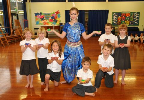 A dancer and pupils at a Kala the Arts workshop at a Basingstoke school