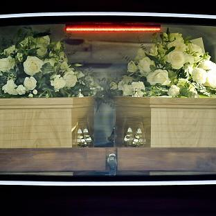 The hearse containing the coffins of Ross and Clare Simons, who were killed when their tandem bicycle was struck by a car