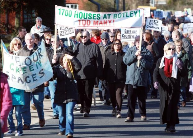 Protesters march against the Boorley Green development
