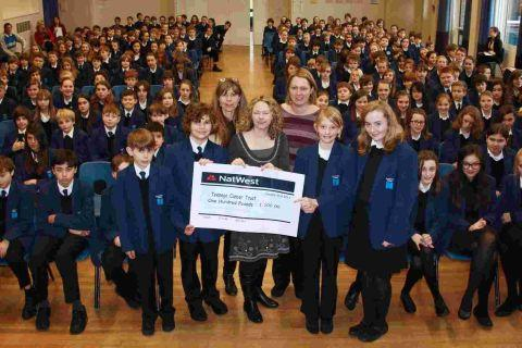 Swanmore staff and pupils with the cheque for the Teenage Cancer Trust