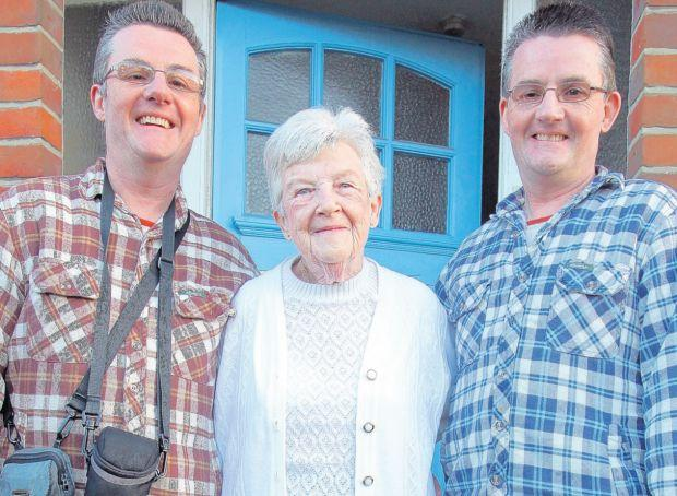 DEVOTED: Margaret Tobutt, 72, with her twin sons, Allan, left, and Mark, right, at home in Southampton.