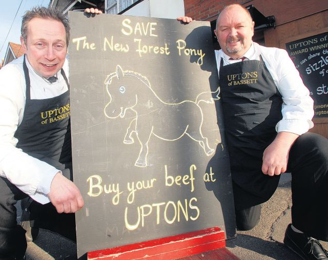 PONY-FREE: Butchers Simon Broadribb, left, and Adrian Mclachlan with the jokey sign outside their shop