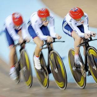 Laura Trott, Dani King and Elinor Barker, left to right, have claimed gold in Minsk
