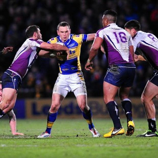 Kevin Sinfield, centre with ball, was on fine form for Leeds but his side could not beat the Australians
