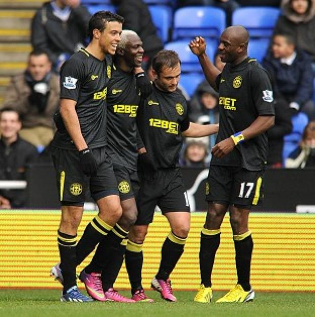 Arouna Kone, second left, scored a brace in Wigan's victory at Reading
