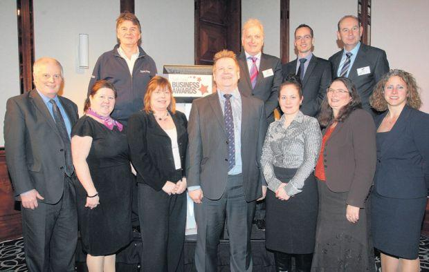 Managing partner of Trethowans Simon Rhodes, centre, with representatives from the South Coast Business Awards 2013 sponsors, and Daily Echo editor Ian Murray, back right.