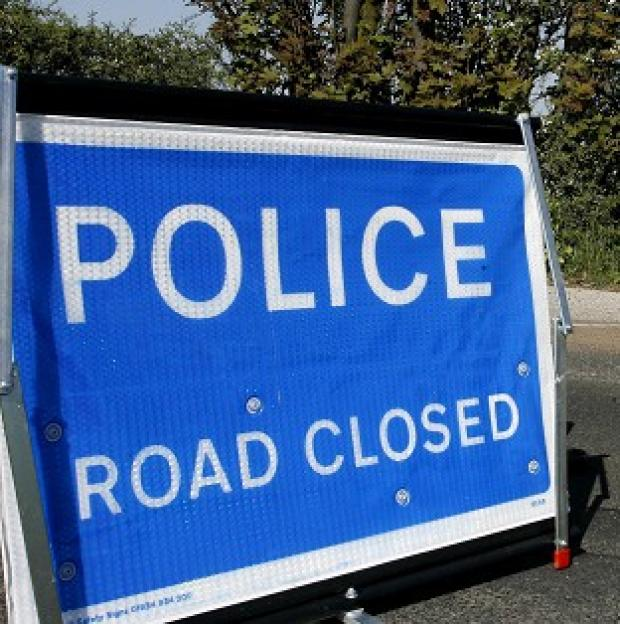 Police have started an investigation after a car driver died when his vehicle collided with an ambulance responding to a 999 call