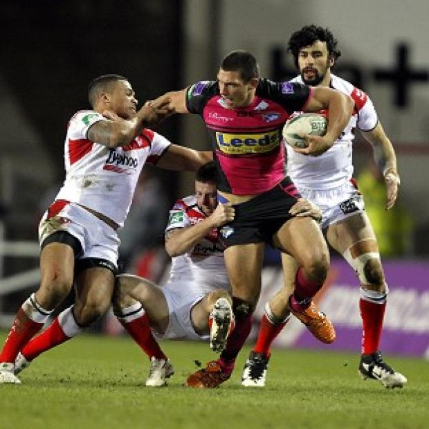 Ryan Hall tries to wriggle free during Leeds' victory at St Helens