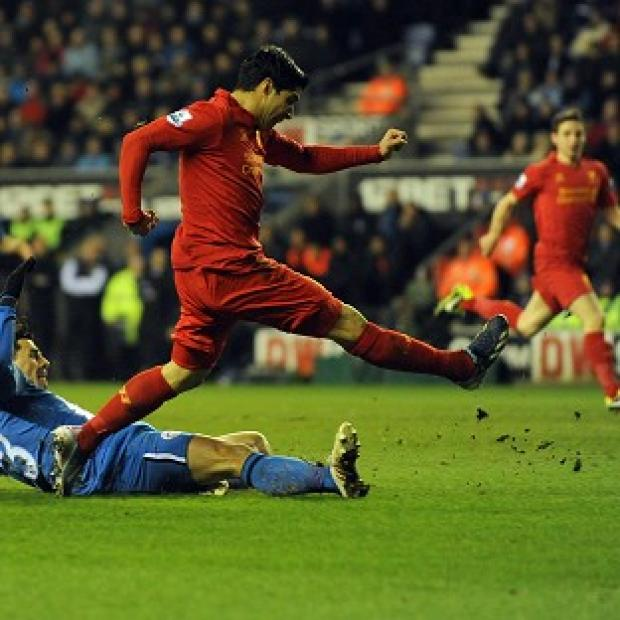 Andover Advertiser: Luis Suarez, centre, completed his hat-trick with Liverpool's fourth goal against Wigan