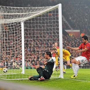 Cristiano Ronaldo, left, nets the winner that knocks Manchester United out of the Champions League
