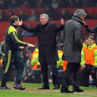 Sir Alex Ferguson, centre, was furious with the decision to send off Nani