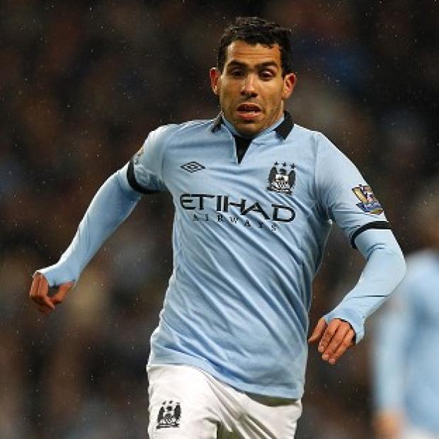 Carlos Tevez is due to answer bail this week after being arrested on suspicion of driving whilst disqualified