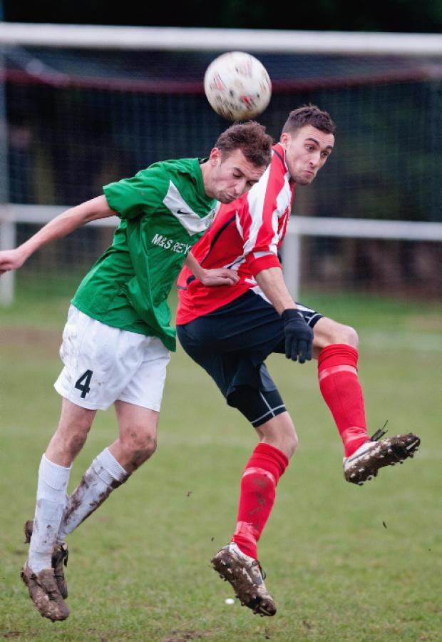 Whitchurch (stripes) had a straightforward victory over Hythe and Dibden at Longmeadow on Saturday