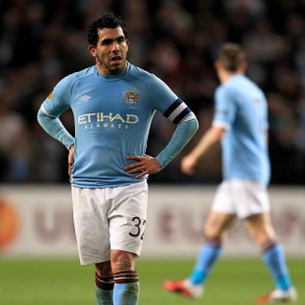 Footballer Carlos Tevez has been charged with driving while disqualified and without insurance