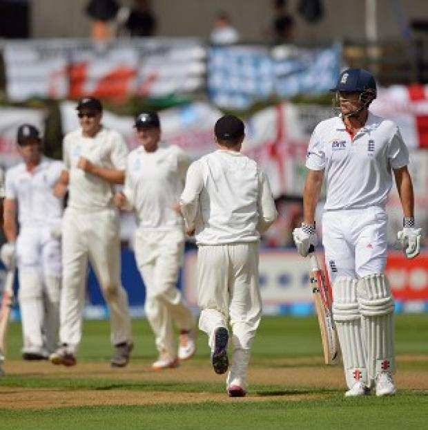 Alastair Cook, second right, is sent back in surprising circumstances on the opening morning