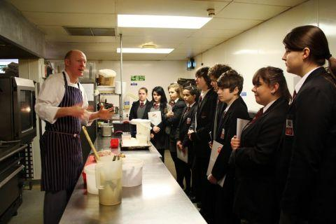 Winchester Hotel head chef Neil Dore gives Westgate pupils an interactive kitchen demonstration