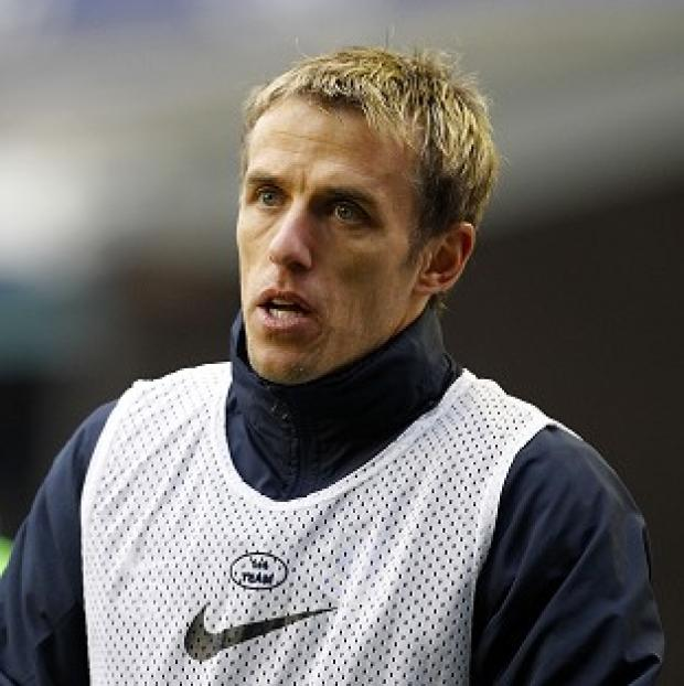 Phil Neville will help coach England's Under-21s this summer