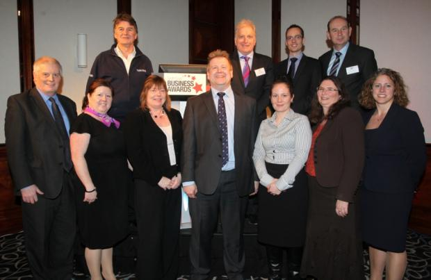 Managing partner of Trethowans Simon Rhodes, centre, with representatives from the event's sponsors, at the launch of the South Coast Business Awards 2013.