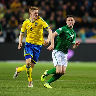 Rasmus Elm, left, and Robbie Keane battle for possession during the 0-0 stalemate