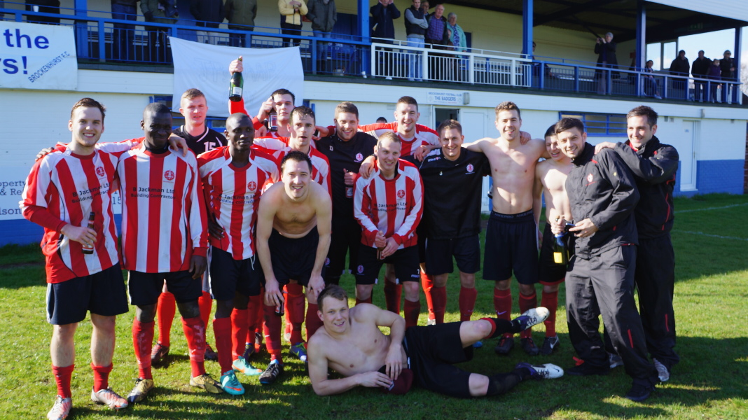 Whitchurch celebrate promotion in front of the main stand at Brockenhurst, who were crowned champions on the same day