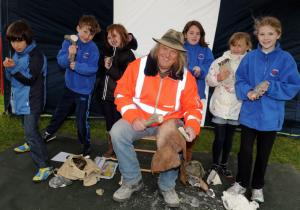 Phil Harding at Danebury Ring with pupils from Wherwell Primary School.