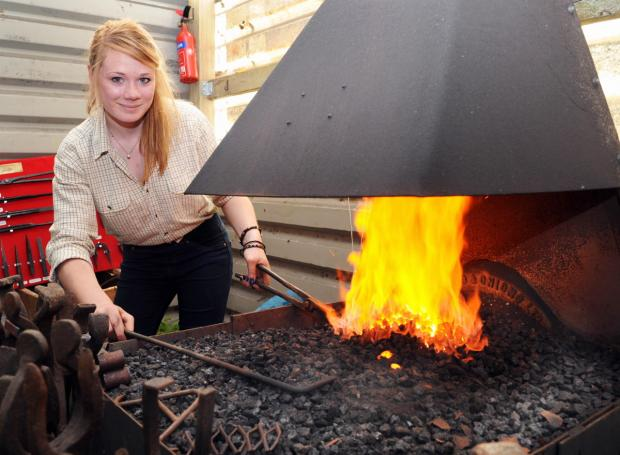 Teenage girl fired up for job at smithy