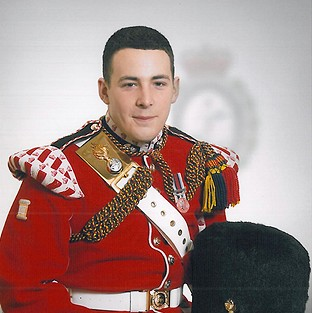 Fusilier Lee Rigby died from multiple cut and stab wounds when he was attacked in Artillery Place