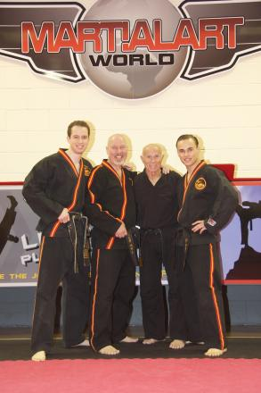 Bill 'Superfoot' Wallace, second right, at Martial Arts World