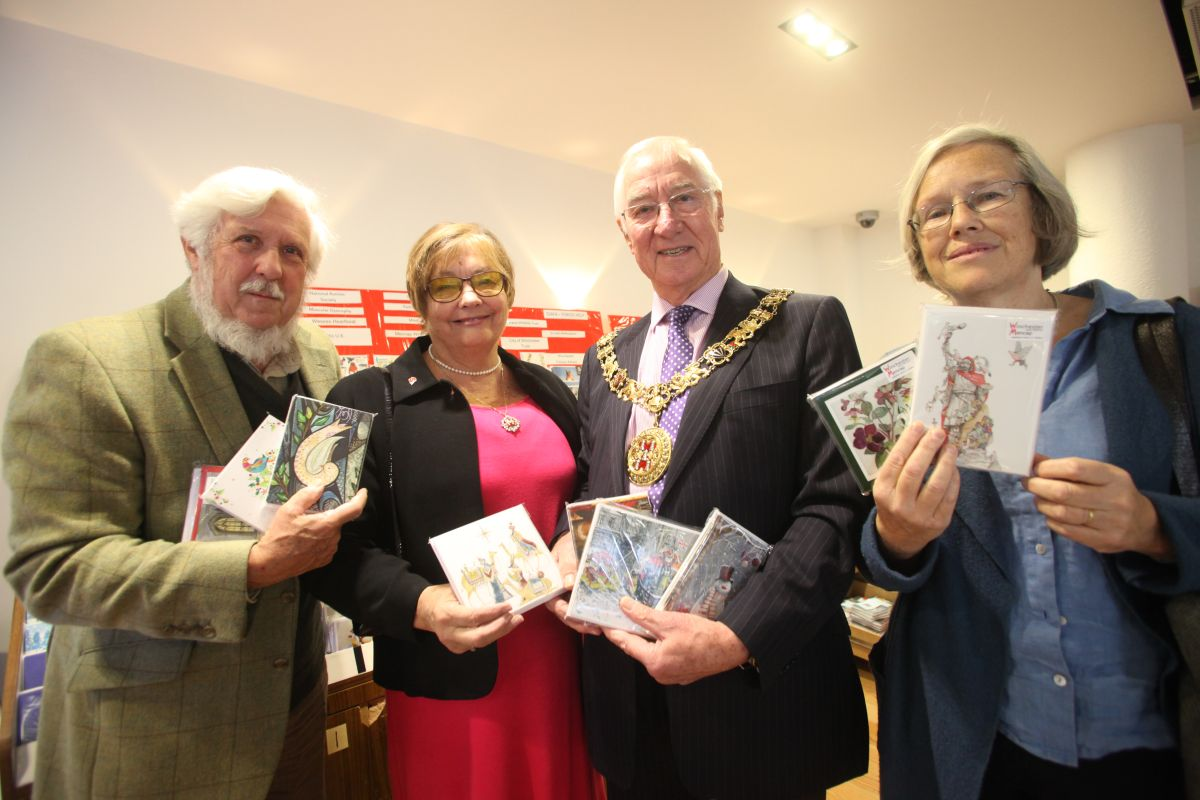 Winchester Mayor and Mayoress Ernie and Barbara Jeffs open the charity Christmas card stands at Cafe Eighteen71