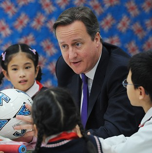 David Cameron meets pupils from Long Jiang Lu Primary School in Chengdu, as part of his three day visit to China