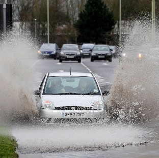Two die as gales cause travel chaos