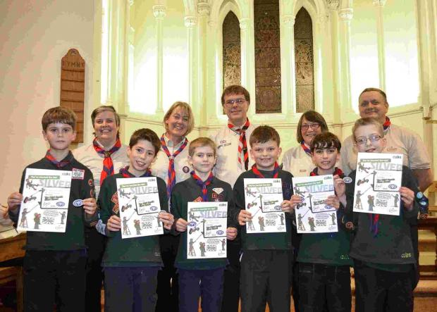 Boys and girls in the Winchester 9th Cubs were given silver awards at the Christmas carol service.