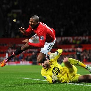 Ashley Young was injured after going to ground under the challenge of Hugo Lloris