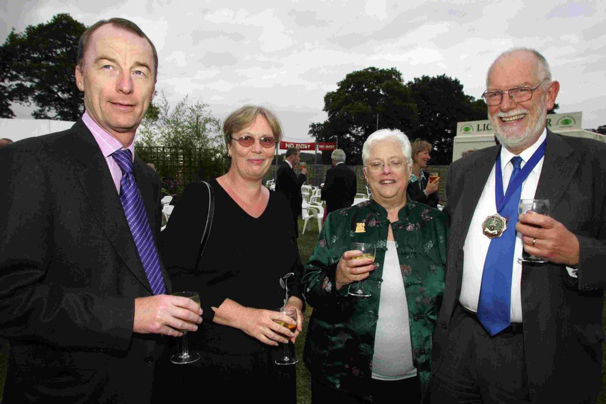 John West (right) pictured next to his wife Bridget and Mary and Paul Kernaghan, then chief constable of Hampshire