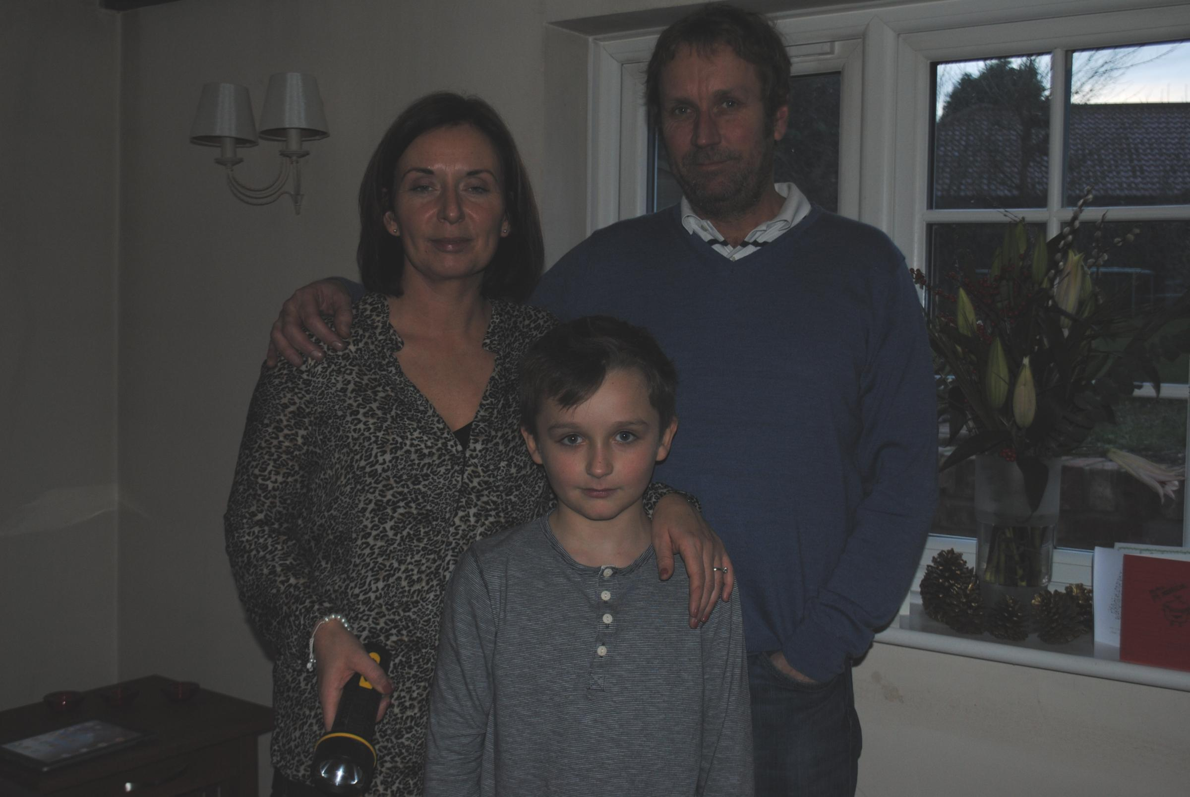 Dummer residents, Vicki and Paul Wadmore with nine-year-old son Harry, who suffered power cuts over Christmas