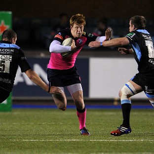 Cardiff Blues' Rhys Patchell is tackled during the Heineken Cup match at the Cardiff City Stadium, Cardiff.
