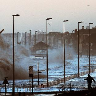 Andover Advertiser: Water covers the coastal roads at Clevelys near Blackpool as large waves crash over the sea defences as high tides and huge waves hit the west coast of the UK.