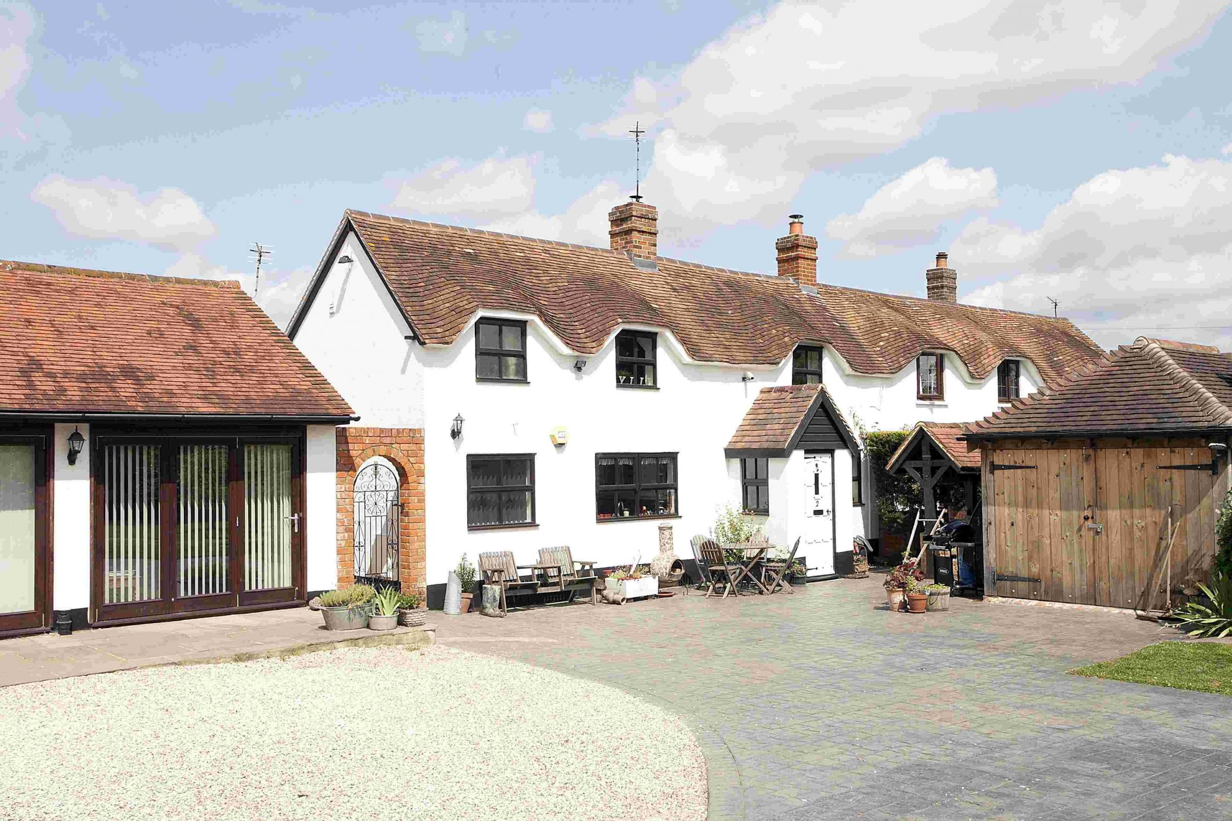 Cherry Tree Cottage, at Pamber Green, near Basingstoke, sold by Carter Jonas, for £475,000 in the autumn of 2013