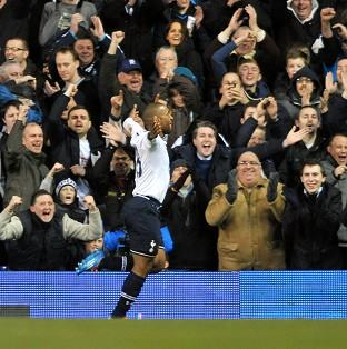 Jermain Defoe celebrates with the Tottenham fans after making it 2-0