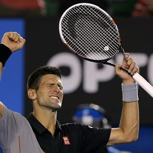 Novak Djokovic of Serbia celebrates after defeating Lukas Lacko of Slovakia in their first round match at the Australian Open tennis championship in Melbourne, Australia, Monday, Jan. 13, 2014..(AP Photo/Aaron Favila)