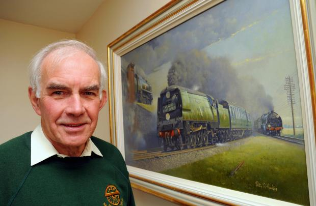 Dr Ian Harrison with the painting commissioned by South of England Friends of the National Rail Museum.